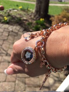 Origami Owl rose gold dangle bracelet.  http://loveablelockets.com