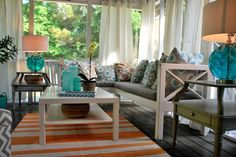 Make your screen porch an outdoor room. You can extend the size of your home by creating an outdoor space that feels like part of your home.  Great seating, a rug, lamps, tables can create another living space for you to enjoy.  Adding curtains gives the space a feeling of privacy like being indoors. Sponsored by Homegoods, Homegoods Happy by Design. (Pillows, lamps, side tables, accessories, chevron ottomans all found at homegoods