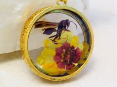 Wasp and flower resin necklace