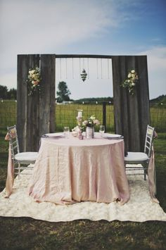 Bride and Groom table // photo by ArielRenaePhoto.com farm wedding, sweetheart table, groom tabl, grooms table, bride, table for two, event styling, backdrop, event planners