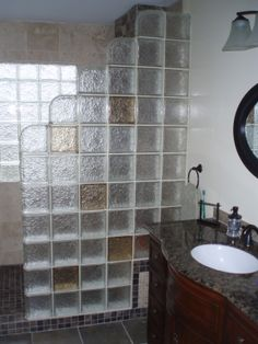 A step down colored glass block wall can add style and streaming light through a bathroom - and it's not hard to install. Click here to learn more - http://innovatebuildingsolutions.com/products/glass-block/glass-block-shower  #innovatebuilding