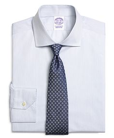 patterned tie on simple blue shirt - blue on blue