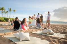 mats and pillows for simple beach wedding