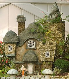 The Primrose Cottage - made of hypertufa. Will have to look into that as a building material.   *******************************************