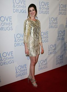 Anne Hathaway Red Carpet Evolution | In sequined Oscar de la Renta at the Love & Other Drugs premiere in Sydney in 2010.