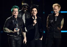 (L-R) Tre Cool, Billie Joe Armstrong and Mike Dirnt of Green Day accept Global Icon award on stage at the MTV Europe Music Awards 2016 on November 6, 2016 in Rotterdam, Netherlands.