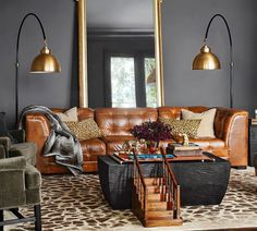 Ken Fulk Quilted Leather Sofa for Pottery Barn and those lights!