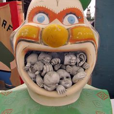 Clowns are creepy, clown mouths filled with old doll parts are even creepier...All Hallows Eve creepy.