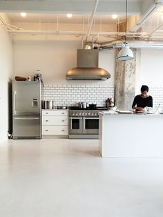 commercial kitchen. like the simple materials--subway tile backsplash with dark grout, high end appliances, clean lines, set up for real cooking
