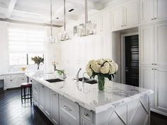 Love that wall of cabinets, marble and the wood floors...great combo...Traditional White Kitchen Featuring Floor-to-Ceili