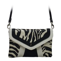 """Shay-Zebra Clutch  Fun and fabulous, Shay features eye-catching contrast stripes and a subtle tab closure. This striking clutch fits inside the exterior pocket on your favorite Grace Adele Bag.    •  Faux leather   •  9"""" L, 6"""" H   •  Detachable shoulder strap with 23.5"""" drop  https://myfashions.graceadele.us/GraceAdele/Buy/ProductDetails/10958"""