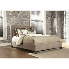 Signature Designs by Ashley  Light Brown Fully Upholstered Queen Bed