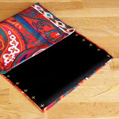 Design your own iPad clutch! Super simple steps and can be completed with hand stitching!