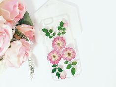 Invite the vibrant beauty of nature to your phone.  Flower Stone has designed these alluring phone cases with REAL dried and pressed flowers on a Clear and Hard Plastic case for you to enjoy and get compliments from others!  FEATURES: - a Great Gift Idea for your loved ones - Provides your phone protection - HIGH QUALITY CRYSTAL CLEAR CASE - 100% REAL FLOWERS   DESCRIPTIONS: Unique flowers are nicely pressed & dried and are placed on the back of the phone case, covered with a layer of cry...