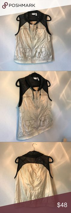 """Chico's Zenergy 1X Cargo Utility Vest Chico's Senergy size 1X utility vest. Black and cream colored. Feels like windbreaker material. Woven 100% nylon. Knit 56% cotton 38% modal & 6% spandex. Bust 21"""" shoulder 16"""" length 24""""   ✨ SUPER FAST SHIPPING ✨ 📦 All of my items ship same or next day! Chico's Jackets & Coats Vests"""