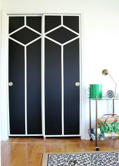 Turn boring flat doors into chic and stunning painted patterned doors with a quart of paint and FrogTape!