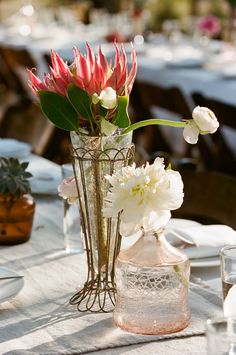 Giant Proteas go a long way for eye-catching centerpieces! See more of this whimsical wedding on #SMP here:   http://www.StyleMePretty.com/2014/05/02/quirky-elegance-at-three-points-ranch/ Photography: Q Weddings - qweddings.com -- Floral Design: http://LorettaFlower.blogspot.com