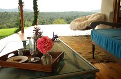 Enjoy your morning tea outside on your bedroom veranda.  Imagine watching the colubus monkeys swinging on the branches in the forest below you... or just listening to the familiar noises of your own home.