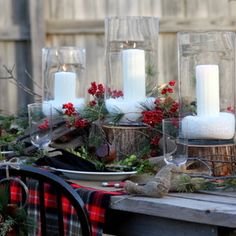 tartan plaid, holly berries, wooden candle stands, and glass hurricane globes.