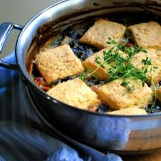 A savory, rib-sticking collard green cobbler with cornmeal biscuits to welcome October.