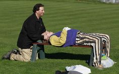 Bill Murray gets chiropractic care at the 2012 AT&T Pebble Beach National Pro-Am golf tournament.