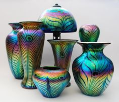 iridescent vases you could maybe spray with an oil or chemical to make it lkke this