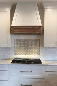 Kitchen Remodeling Ideas Beautiful White Farmhouse Kitchen with Decorative Tile Backsplash and Wooden Oven Hood - Modern vintage handmade tile for classic kitchens and bathrooms. Eco-friendly and handcrafted by artisans in our Colorado studio. White Farmhouse Kitchens, Rustic Kitchen, New Kitchen, Kitchen Decor, Kitchen Ideas, Country Kitchen, Tuscan Kitchens, 1970s Kitchen, Kitchen Pulls