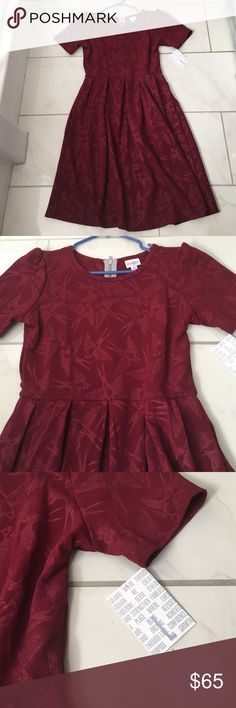 Lularoe bird Amelia size L Super awesome bird print in maroon. Size Large. Was too big for me. Still has tags and never worn! It's so pretty! Has pockets! I paid $72 for the dress. LuLaRoe Dresses Midi