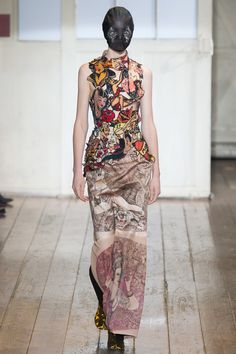 A wearable silhouette overlaid by Maison Martin Margiela's commentary on 2014's universalality of the tattoo culture. Highlighted by a Renaissance oil wing at the Met graphic printed skirt. Art as clothing as commentary as art. All Margiella.