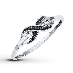 An infinity symbol traced with round Jared Vivid™ black diamonds is the meaningful centerpiece of this ring for her. A row of baguette white diamonds adds contrast to the sterling silver band, bringing the total diamond weight to 1/20 carat. Black diamonds are treated to permanently create the intense black color. Diamond Total Carat Weight may range from .04 - .06 carats.