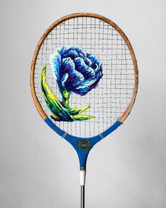 using colorful thread and vintage tennis rackets, artist danielle clough forms vibrant floral compositions interwoven between the mesh of nylon cord.