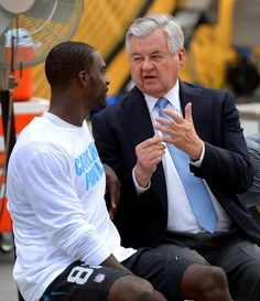Carolina Panthers wide receiver Jerricho Cotchery, left, and owner Jerry Richardson, right, talk along the sidelines on Thursday, September 3, 2015 at Heinz Field in Pittsburgh, PA.