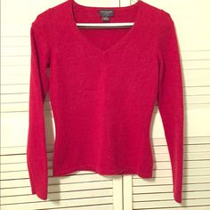 Ann Taylor Red Cashmere Sweater This item has been previously worn. It is in gently used condition, it bears no signs of wear. The lines you see in the pictures are wrinkles from the way it was folded at the dry cleaners. It is 100% Cashmere. It is size Petite Small and fits sizes 4/6. It looks great with skinny jeans and black heels! Perfect for a casual day or night out. Ann Taylor Sweaters V-Necks