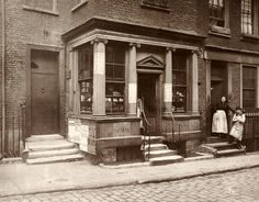 Henry Dixon and Son. Macclesfield Street, Soho, London. 1883, by the Society for Photographing the Relics of Old London. The society from 1875-1886 undertook the producing of a photographic record of the architecture, they feared could be under threat from development.  Predictably, this building no longer exists.