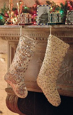 An elegant mantel deserves equally elegant stocking holders.