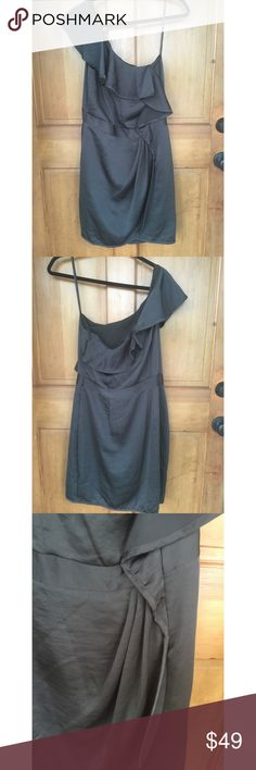 "BCBGeneration One Shoulder Black Gray Dress New 12 Nwt BCBGeneration Charcoal One Shoulder Dress, 12. Lined. 100% Polyester. Laying flat it measures approximately: Shoulder to Bottom 36"", Armpit to Armpit 18"", Waist 15"". BCBGeneration Dresses One Shoulder"