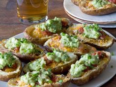 Trade in the tortilla chips for restaurant-style potato skins topped with all the good stuff: guacamole, sour cream, scallions, cheese, bacon and more. (And guacamole does not cost extra.) Get the recipe.