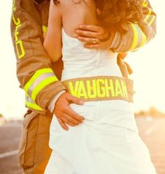fireman ( I didn't like his hand, though!) but I can imagine this photo with both of is hands on her back