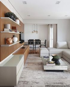 The slatted wooden panel and the coffee table bring sophistication to the TV room. Tv Wall Design, House Design, Web Design, Big Sofas, Home Tv, Living Room Tv, House Plans, Sweet Home, New Homes
