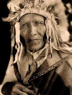 Ogalala Indian Chief. It was taken in 1905 by Edward S. Curtis. The image shows a Head-and-shoulders portrait of this Oglala chief.
