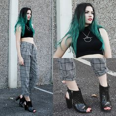Love the hair, interesting necklace, nice trousers... personally hate the shoes