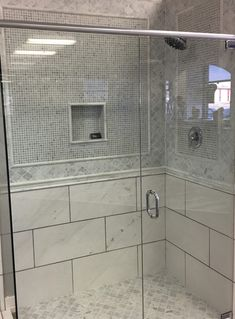 """Beautiful Carrara Marble Shower Tile Ideas. Arabesque Shower Floor. 5/8"""" square mosaic bordered by Carrara marble arabesque tile. Carrara marble bathroom design 