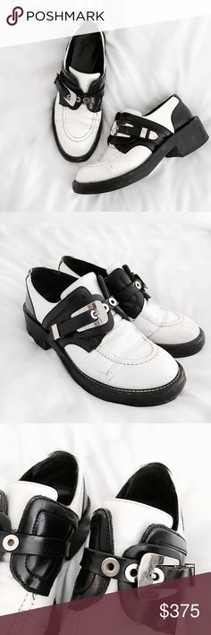"""Balenciaga """"Ceinture"""" Derby Buckle Loafers The iconic Balenciaga Ceintures in a loafer silhouette- features a low rise, classic Balenciaga silver and gold derby buckle and paneled black and white shiny leather. Chunky stacked low heel w platform. Leather sole & insole. These show wear- creasing/slight cracking where expected, general wear/marks to upper and sole. Slight scratching to hardware. Can easily be polished to better shape! Still have lots of life left. Size EU40- I would recommend…"""
