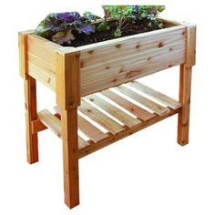 """Transform your home into a lush spring retreat with this garden essential, perfect for showcasing vibrant bouquets and fragrant herbs.   Product: Garden bed with shelfConstruction Material: WoodColor: NaturalFeatures:  Made in the USAHolds 7 """" of soilShelf for storage Dimensions: 35.25'' H x 36'' W x 18.25'' D"""