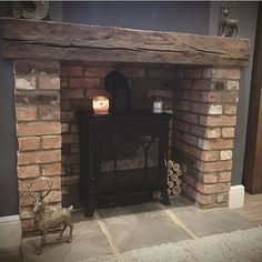 Terrific Pictures Brick Fireplace log burner Concepts It sometimes makes sense to be able to skip the upgrade! Instead of taking out a aged brick fireplace , lower your expen Brick Fireplace Log Burner, Home Fireplace, Living Room With Fireplace, Fireplace Design, Brick Hearth, Fireplace Trim, Fireplace Ideas, Vintage Fireplace, Rustic Fireplaces