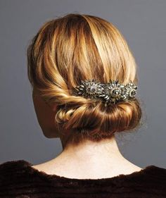 To create this look, use a Sarah Potempa Half-Up ($9, ulta.com), a three-inch-long piece of flexible foam with a slit in the middle. Slide hair, an inch from the ends, into the slit, then roll the foam horizontally up to the nape. Secure the roll with bobby pins. The final touch? A glittery comb slid atop the roll.