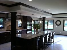 Double raised-panel columns are used to hide conduit in this kitchen. The soft maple is stained to match the new island and existing cabinetry. Column Wrap, Wooden Columns, Entryway Ideas, Raised Panel, Fireplace Surrounds, Cladding, Basement, Home Improvement, House Design