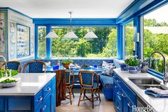 This cozy, happy, gorgeous little kitchen in East Moriches, Long Island, was designed for fashion executive Rose Marie Bravo by Beth Martell and Enda Donagher. I could move right in!