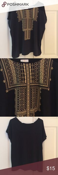 "Flowy black patterned boho top Gorgeous black boho top with geometric lacy printed cream design at neckline. Very flowy and flattering to any figure. Size Large. Only worn once. Excellent condition. 100% rayon. Approx 25"" from shoulder to hem. Save 15% when you bundle 2 or more items. Charming Charlie Tops Blouses"