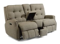 The Devon power reclining loveseat with console and power headrests features tufting and puckered stitching displayed on a traditional style.